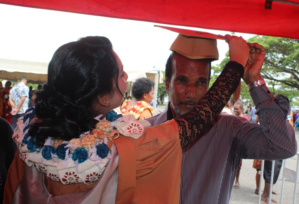 Graduate Shafika Ahmed puts her graduation hat on proud father Mohammed Rafiq after the USP graduation on March 21,2019.Photo:Simione Haravanua.