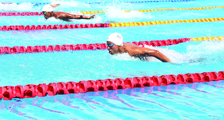 Coach Impressed With Swimmers' Times