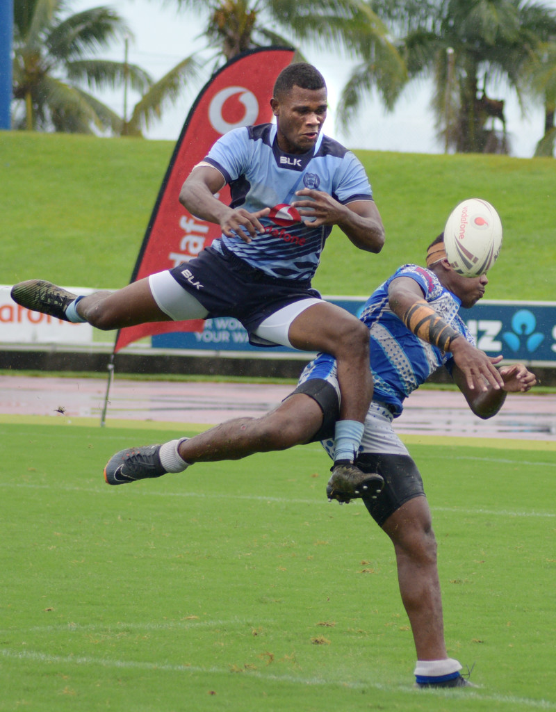 Queen Victoria School Centre, Rawama Matakada and Nasinu Lock Joseva Vakarewa battle for possession during Secondary School rugby league under 19 semi-final at ANZ Stadium on March 31, 2019. Photo: Ronald Kumar.