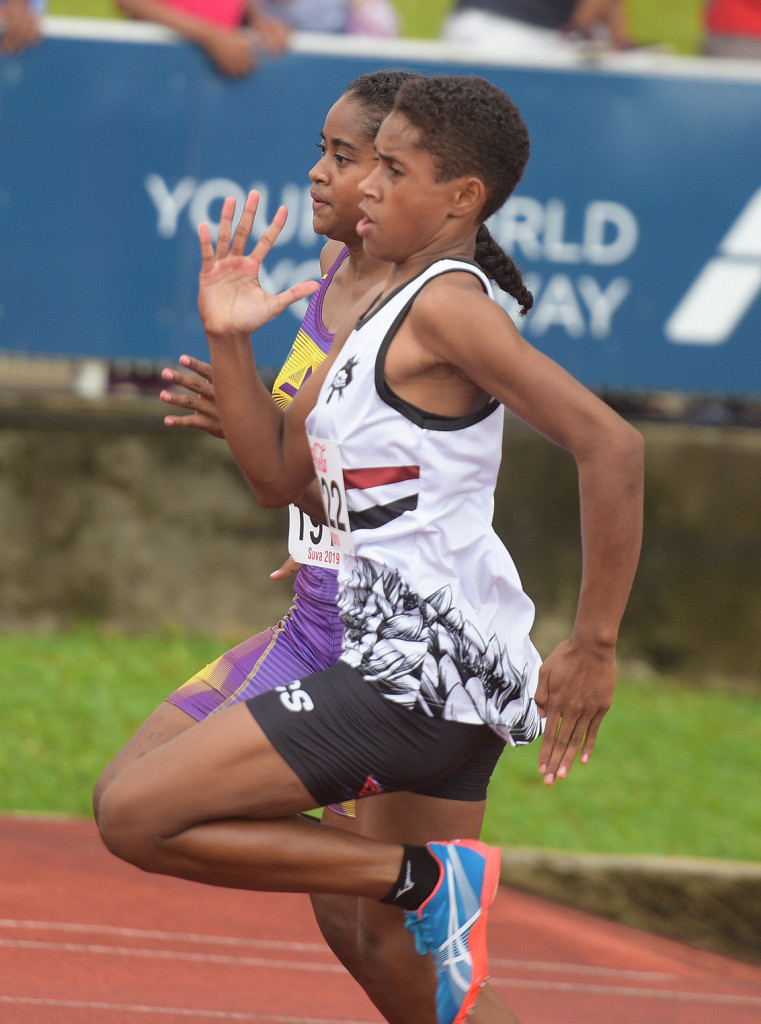 Amale Navabale of ADi Cakobau School and Mereani Bo of Sigatoka Methodist go neck to neck during Inter-Girls 200 meters heats . Photo: Ronald Kumar.