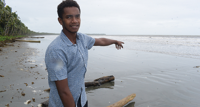 Tomasi Naborisi 18 shows where he found the body of 15 year-old Rayshal Roy at Naselai Beach in Tailevu on April 22, 2019. Photo: Ronald Kumar.
