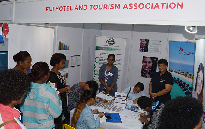 Youths sign up for opportunities available at Fiji Hotel and Tourism Association booth during National Job fair at FMF Gymnasium on April 24, 2019. Photo: Ronald Kumar.