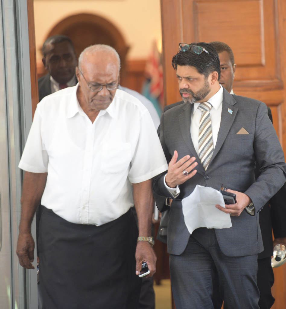 Attorney General and Minister for Economy Aiyaz Sayed-Khaiyum assist Penisoni Saukelea outside Parliament on April 2, 2019. Photo: Ronald Kumar.