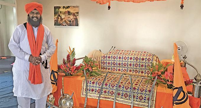 Head Priest Bhai Pritam Singh Shokar serving the Guru Granth Sahib at the Samabula Sikh Temple. Photo: Neelam Prasad