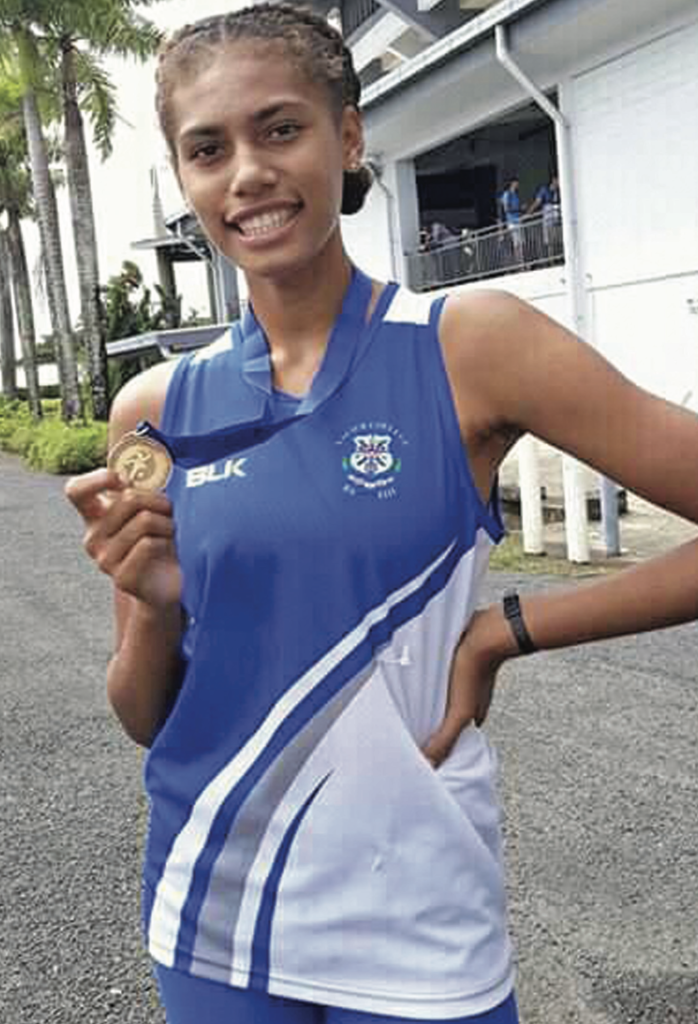 Shawntell Lockington shows off her gold medal after winning the senior girls high jump event during the 2019 Coca Cola Games at the ANZ Stadium in Suva. Photo: Grace Narayan