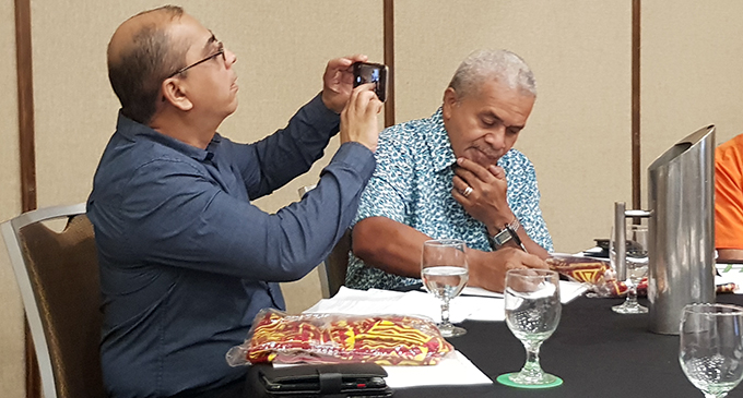 USP head of journalism Shailendra Singh takes a photo with Matai Akauola during the Fiji Sports Media symposium in Suva on April 23, 2019.