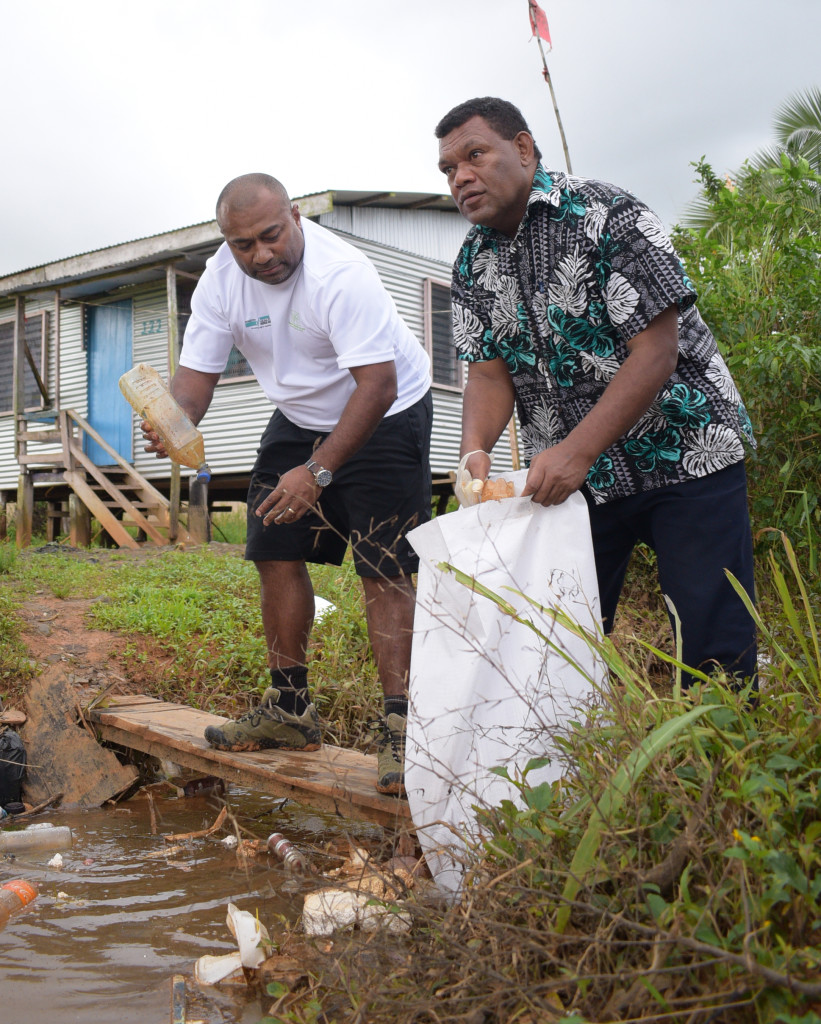 Minister for Health Dr. Iferemi Waqainabete (left) and Pastor Manua Kalaunaviti while cleaning up at Waidamudamu settlement following the launching of Rewa subdivision clean-up campaign on April 20, 2019. Photo: Ronald Kumar.