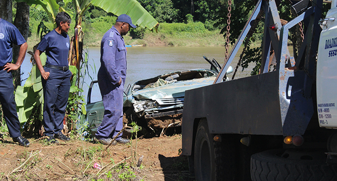 Police and Fire Authority officers recover the car that was driven by the late Taslim Ali in Baulevu Nausori on April 29,2019.Photo:Simione Haravanua.