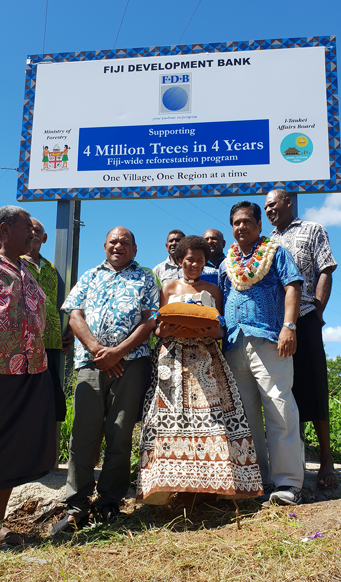 "Minister of Forestry Osea Naiqamu with Fiji Development Bank General Manager Relationship & Sales, Shaukat Ali, forestry staff and Vatutu villagers during the launching of the ""Four Million Trees in Four Years"" Initiative in partnership with FDB at Vatutu Village in Nawaka at Nadi yesterday.   Photo: Mereleki Nai"
