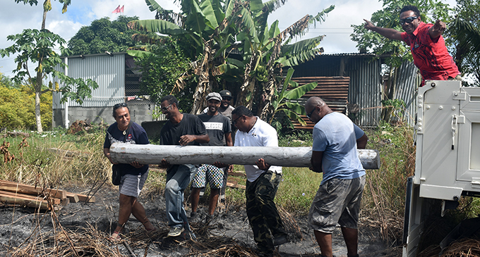Radio personality, Michael Faga and friends at work in building a proper shelter for Atelaite Koto and her son in Dratabu, Nadi
