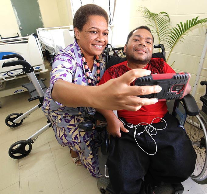 Minister for Women, Children and Poverty Alleviation Mereseini Vuniwaqa takes a selfie with a member of the Spinal Injuries Association of Fiji. Photo: DEPTFO News