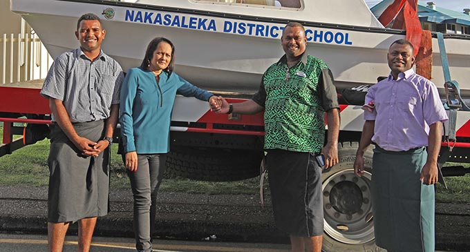 Minister for Education, Heritage and Arts Rosy Akbar (second from left) handing over the boat as part of Government's transport assistance to Nakasaleka District School in Kadavu. Photo: DEPTFO News