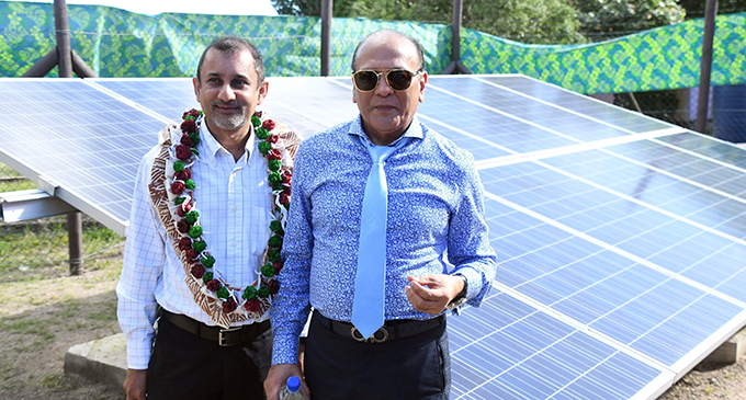 Sunergise Director, Ajay Raniga and Energy Fiji Limited Director, Hasmukh Patel by the solar grid on Vio Island. Photo: DEPTFO News
