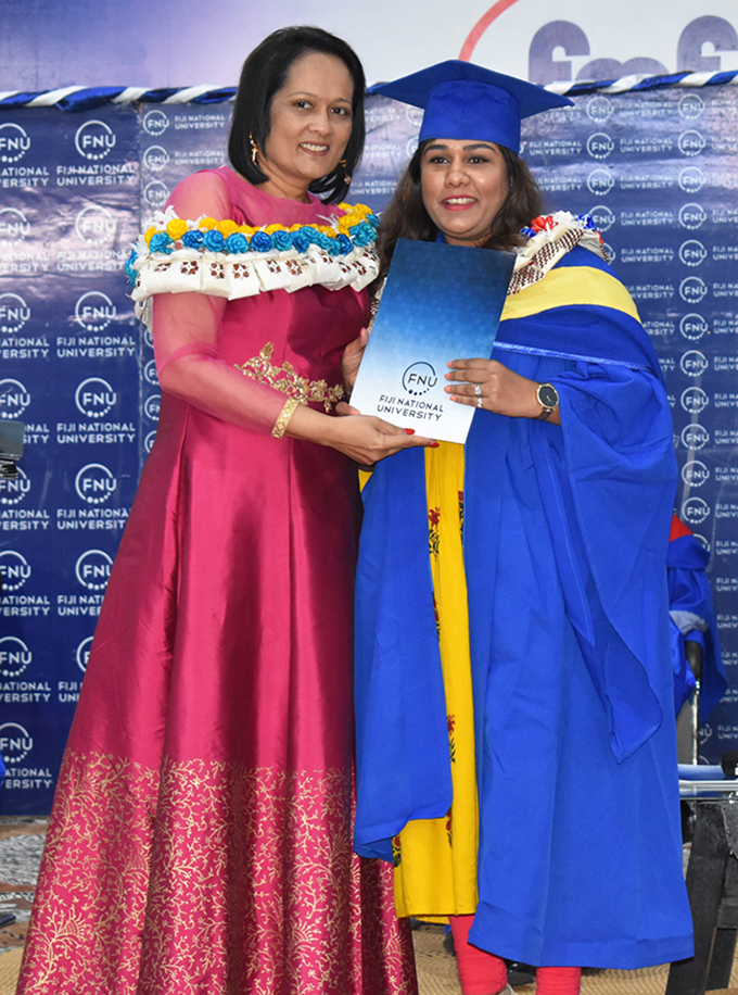 Chief Guest, Minister for Education Rosy Akbar presents a certificate to a FNU College of Humanities and Education graduate on May 1, 2019. Photo: Fiji National University