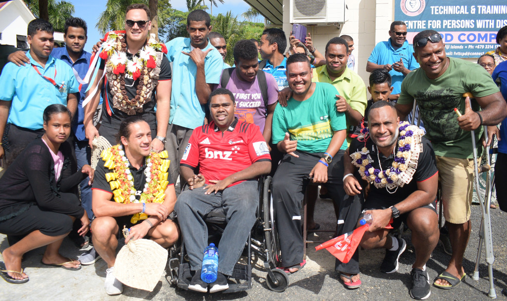 Crusaders full back Israel Dagg, Ereatara Enari and Fiji born Crusaders outside back, Manasa Mataele with students from Fiji Vocational Technical and Training Centre for persons disabilities on May 30, 2019. Photo: Ronald Kumar.