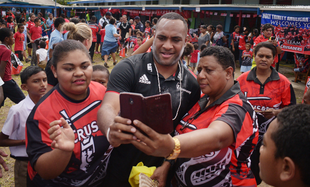 Crusaders outside Manasa Mataele with local fans at Holy Trinity Anglican Primary School during school visit on May 30, 2019. Photo: Ronald Kumar.