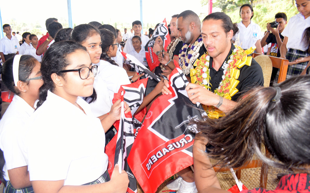 Crusaders half-back Ereatara Enari , outside Manasa Mataele and full-back Israel Dagg signs autographs for students of Jai Narayan College during school visit on May 30, 2019. Photo: Ronald Kumar.