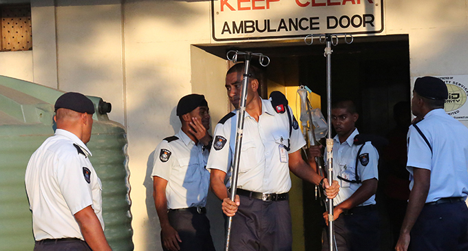 Fiji Police officers assist in the relocation of patients and equipment at the CWM Hospital in Suva after its boiler caught fire on Sunday afternoon 26 May, 2019. Photo: Simione Haravanua