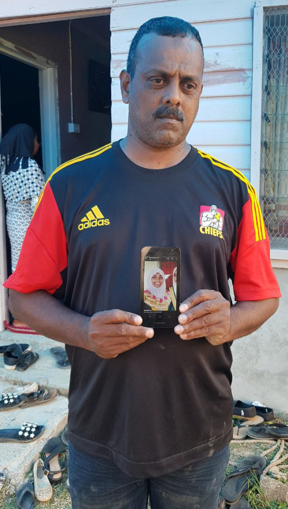 Dad, Mohammad Imraz Sheikh holding the picture of his daughter, Nurainah Sheikh at Mulomulo Settlement in Nadi on May 23, 2019.