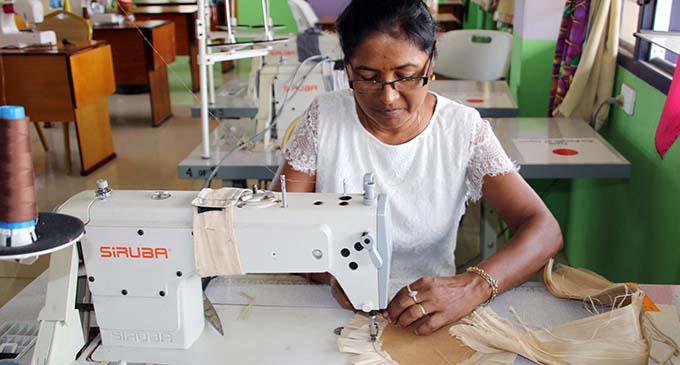 Nalini Devi sewing the Iri for FNU graduates .  Photo: FNU