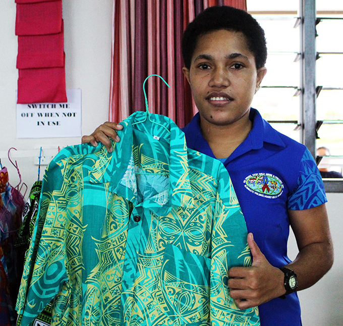 Maria Miriama holding a shirt she sewed at the Makoi Women's Vocational Training Centre on May 4, 2019. Photo: Sydnee Gonzalez.