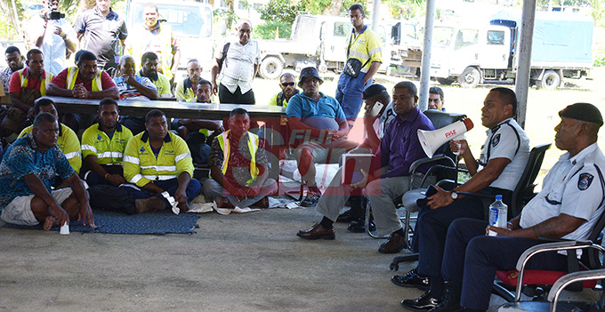 Divisional Police Commander Sakeo Ganivatu while talking contracted workers, who had their employment came to end by as of 30th April with Water Authority of Fij at WAF Wailuku depot on May 1, 2019. Photo: Ronald Kumar.