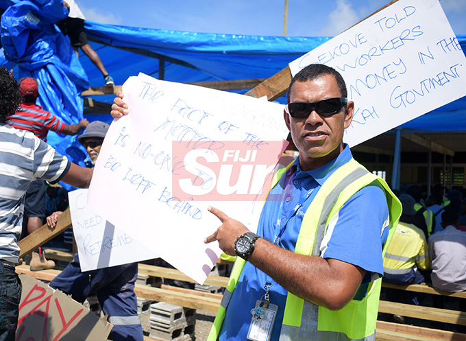 Contracted workers, who had their employment came to end by as of 30th April with Water Authority of Fiji put up placard as they gathered at WAF Wailuku depot on May 1, 2019. Photo: Ronald Kumar.
