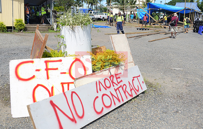 Contracted workers, who had their employment came to end by as of 30th April with Water Authority of Fiji with placard as they set at WAF Wailuku depot on May 1, 2019. Photo: Ronald Kumar. Gathered