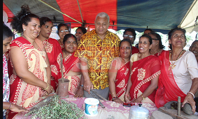Prime Minister Voreqe Bainimarama with women from the Nausori women centre during the Fiji Girmit 140th Anniversary celebrations at Albert park Suva on May,11,2019.Photo:Simione Haravanua.