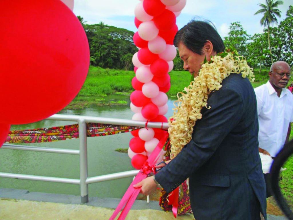 Ambassador of Japan to the Republic of Fiji Masahiro Omura cuts the ribbon during the opening of the Visama Village in Nakelo, Tailevu