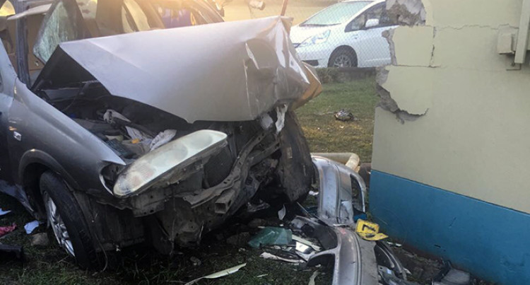 Taxi Driver Fights Off Robbers, Crashes Into House
