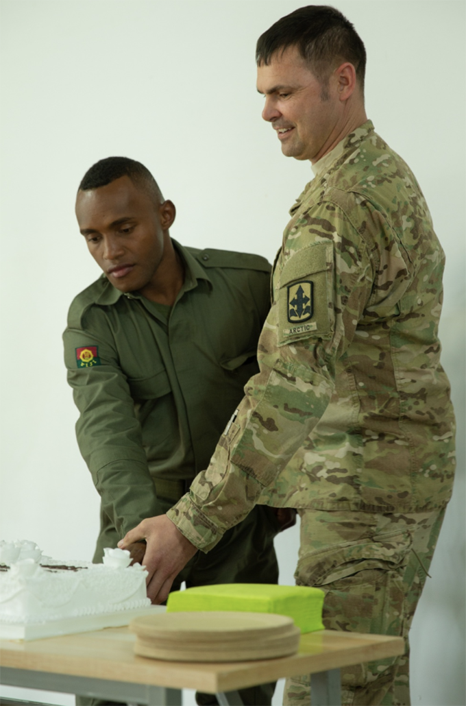 U.S. Army Sgt. 1st Class Daniel Brown, right, and RFMF Pvt. Vilimoni Drotini cut a cake to  celebrate the 244th birthday of the U.S. Army during Khaan Quest 2019 at Five Hills Training Area, Ulaanbaatar, Mongolia.  Photo: U.S. Marine Corps, Lance Cpl. Kindo Go