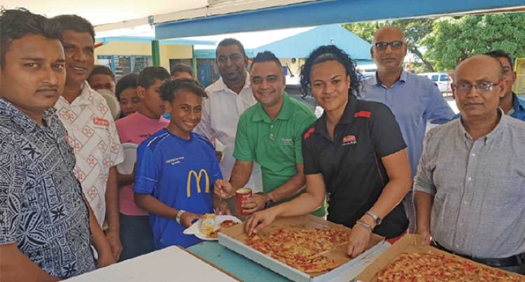 Pizza Treat Leaves 120 Children Smiling