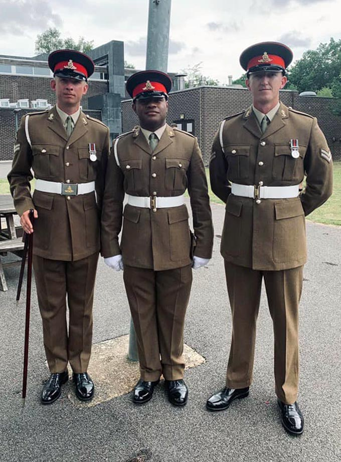 Private Sailasa Laudola with two of his colleagues in the British Army.