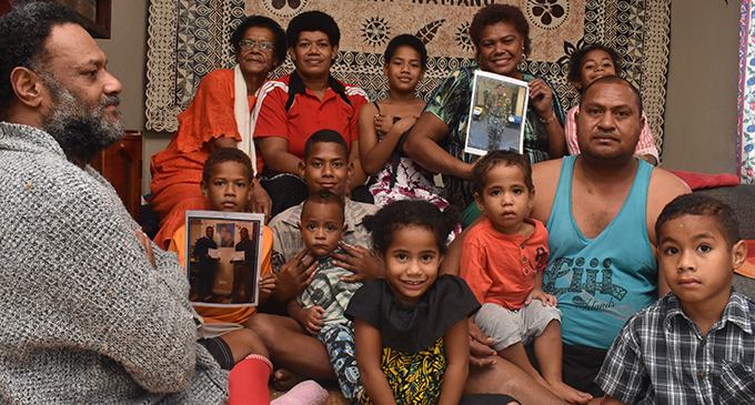 Mum Salome Voliti (back) holds a picture of her son Sailasa Laudola as family members show their support at Korovuto Village in Nadi on July 27, 2019. Photo: Waisea Nasokia