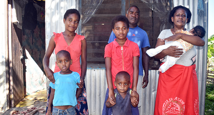 Family Thanks Government for Help In Sending Children To School