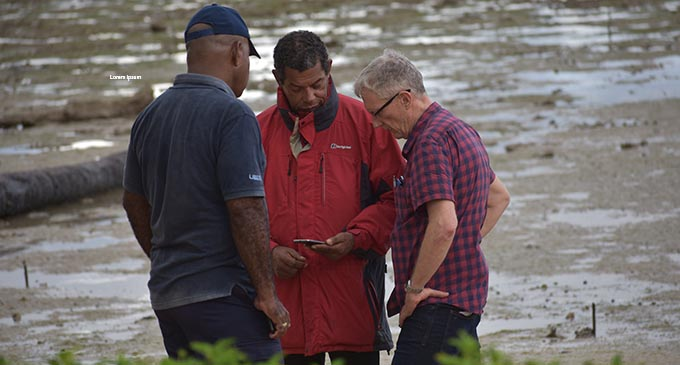 Crash investigator Andrew McGreggor (right), discussing possible flight pathways with rescue personnel on August 5, 2019. Photo: Shalveen Chand
