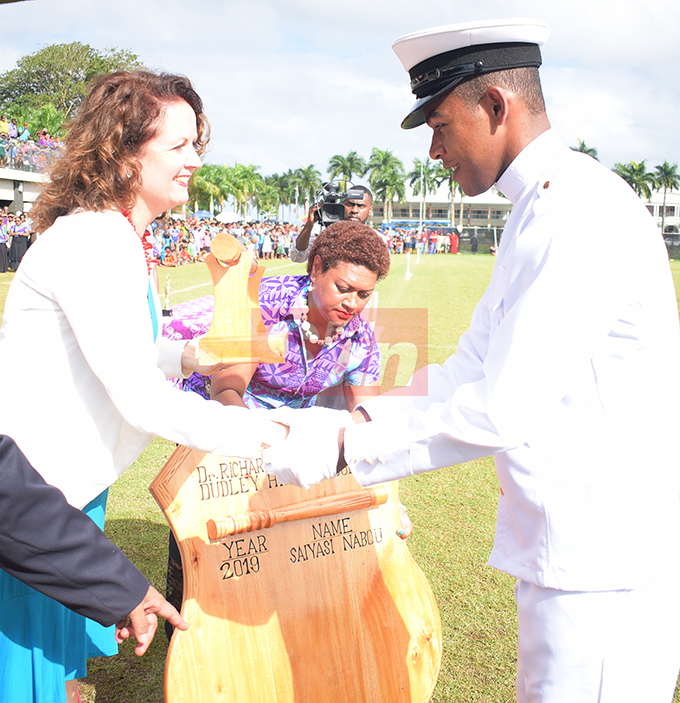 British High Commissioner to Fiji Melanie Hopkins awards Baton of honor to Saiyasi Nabou during Dudley High School Navy Cadet Passing out Parade at Albert Park in Suva on August 9, 2019. Photo: Ronald Kumar.