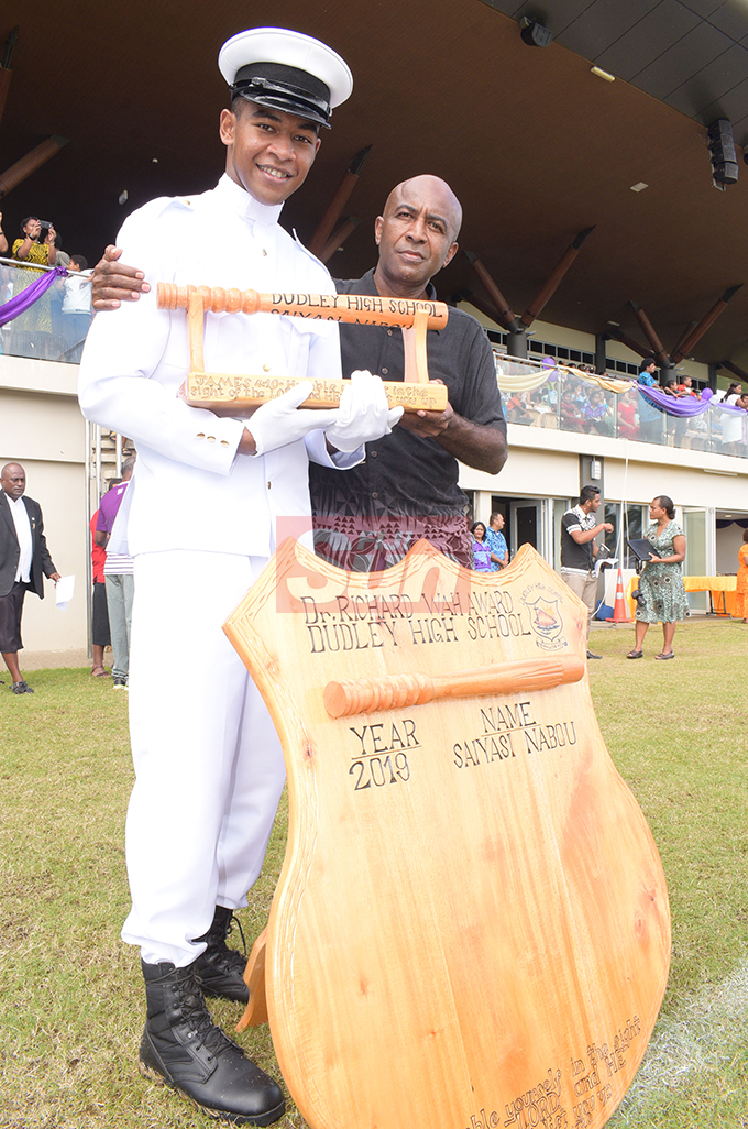 Dudley High School Navy Cadet Passing out Parade baton of honor winner Saiyasi Nabou with his father, Jope Nabou  at Albert Park in Suva on August 9, 2019. Photo: Ronald Kumar.
