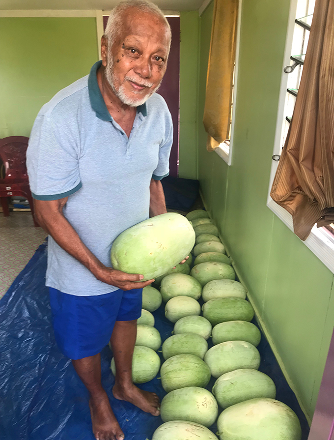 From left: Fani Cheer with his watermelons which he harvested at Karavi on August 22, 2019. Photo: Charles Chambers