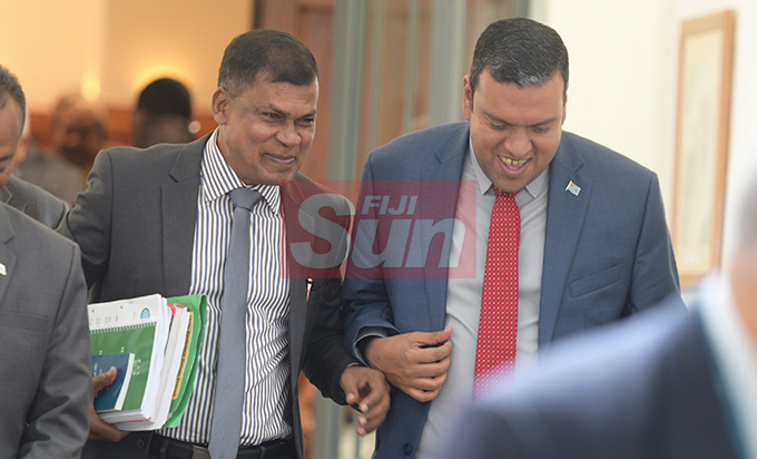 Opposition Member of Parliament Biman Prasad with Minister for Lands Ashneel Sudhakar outside Parliament on August 7, 2019. Photo: Ronald Kumar.