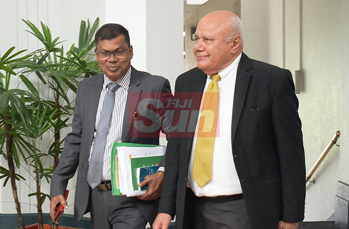 Opposition MP, Biman Prasad and Viliame Gavoka  outside Parliament on August 7, 2019. Photo: Ronald Kumar.