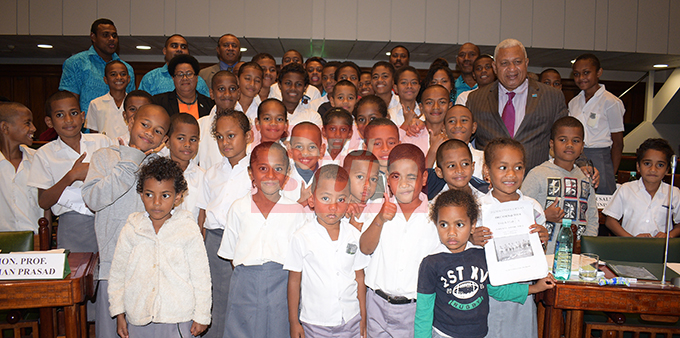 Prime Minister Voreqe Bainimarama, Assistant Itaukei Affairs Minister Selai Adimaitoga and Opposition MP, Ro Filipe Tuisawau with visiting students, teachers and parents of Nukui Village Primary School of Rewa in Parliament on August 7, 2019. Photo: Ronald Kumar.