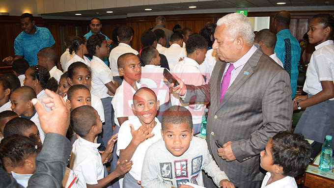 Prime Minister Voreqe Bainimarama with visiting students, teachers and parents of Nukui Village Primary School of Rewa in Parliament on August 7, 2019. Photo: Ronald Kumar.