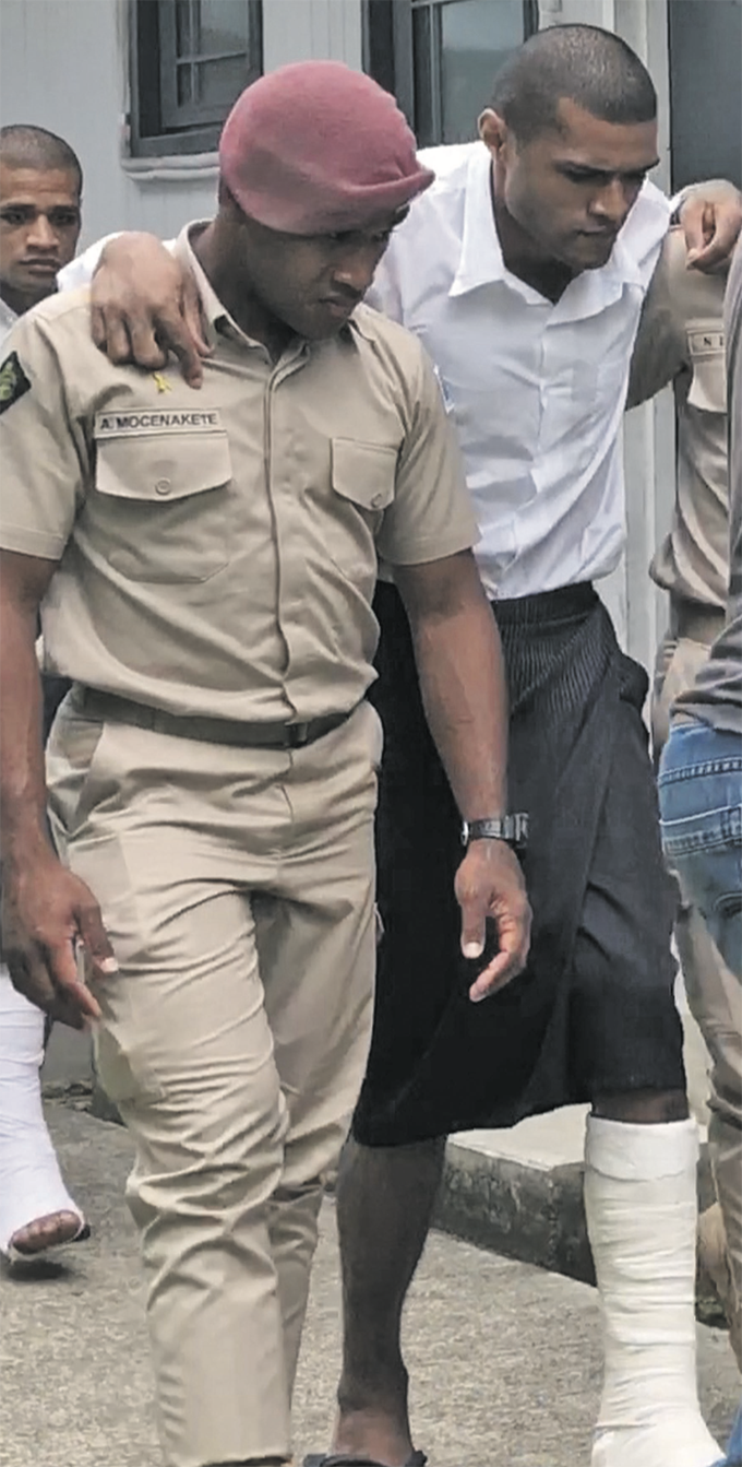Mesulame Waqabaca (in leg cast), outside the Magistrates Court in Suva on January 12, 2019.  Photo: Selita Bolanavanua