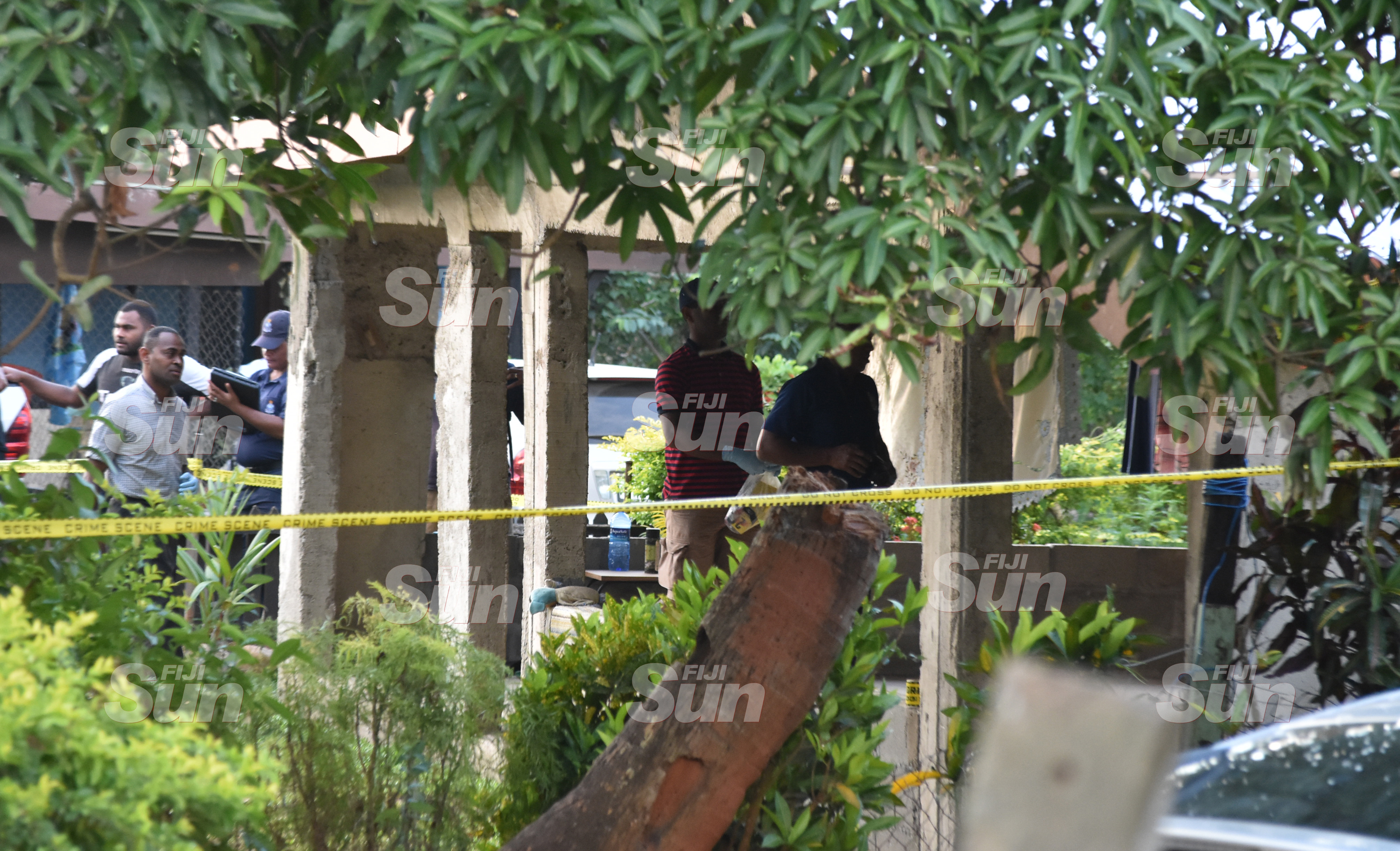 Police Forensic team at thier home in Legalega, Nadi yesterday. Photo: WAISEA NASOKIA