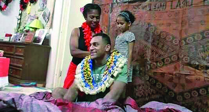 All Blacks winger Sevu Reece is welcomed by his family in Nadi on August 18, 2019