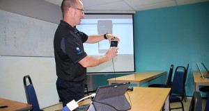 ADR Sales and Development Manager, Peter MacKenzie demonstrates the functions of the new hand-held meter reading devices at the WAF Training Room, National Office in Nasinu. Source: WAF