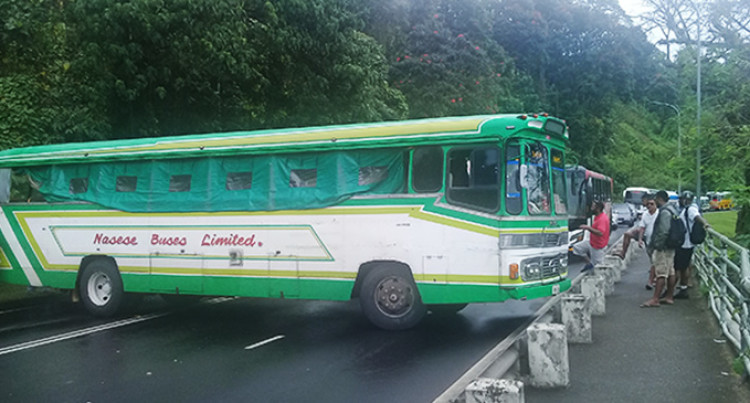 Bus Crashes Into Taxi, Causes Roadblock