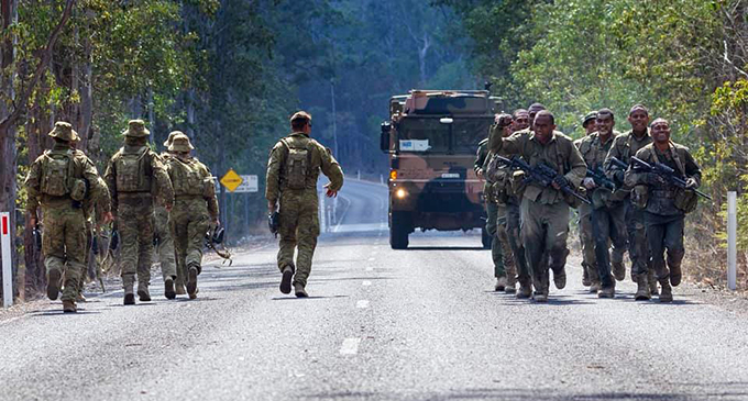 The Republic of Fiji Military Forces team cheer on an Australian Army team as they pass each other during the competition. Photo: 7th Brigade - Australian Army